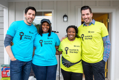 Drew and Jonathan Scott with future Habitat homeowners Amanda and Ashlee at the front door of Amanda's new home in Nashville today. The Scott brothers helped Amanda and Ashlee build their new homes as part of Habitat for Humanity's national Home is the Key campaign.