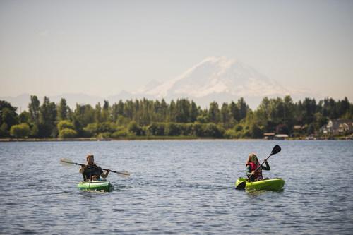 Kayakers enjoy Lake Meridian and views of Mount Rainier during a visit to Kent, Washington.