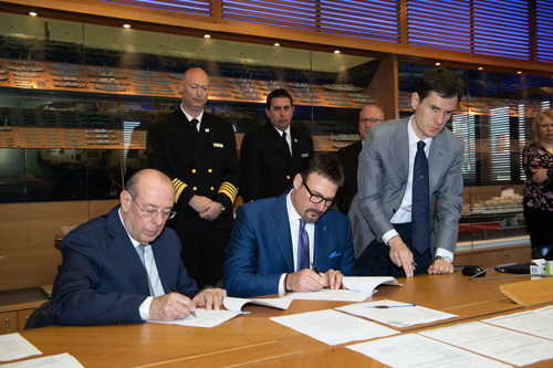 Richard Meadows, president of Seabourn, and Paolo Capobianco, director,  Fincantieri Shipyard Sestre, sign documents to complete the delivery of Seabourn Ovation today. The ship is the fifth ultra-luxury vessel in Seabourn's fleet and will spend the summer 2018 season sailing in Northern Europe. (Photo credit: Fincantieri)