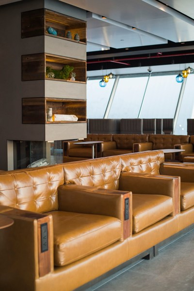 We included a fireplace to give more of a West Coast vibe, as well as some fun lighting fixtures and a custom sofa with power at every seat.