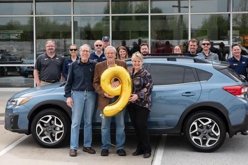 Subaru of America, Inc. sells nine-millionth vehicle (L to R in foreground): Dr. Hershey Garner (Crosstrek owner); Don Nelms (owner, Adventure Subaru); Denise Garner (Crosstrek owner)