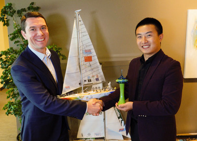 Limeng and John exchange city gifts
