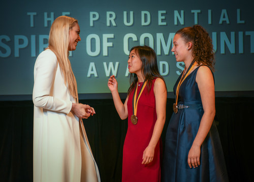 Olympic gold medalist and World Cup champion Lindsey Vonn congratulates Michelle Qin, 17, of Santa Barbara (center) and Autumn Bright, 13, of Portola Valley (right) on being named California's top two youth volunteers for 2018 by The Prudential Spirit of Community Awards. Michelle and Autumn were honored at a ceremony on Sunday, April 29 at the Smithsonian's National Museum of Natural History, where they each received a $1,000 award.