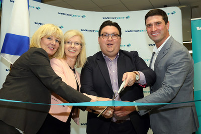 WestJet inaugurates Halifax/Gatwick flight - From l-r: Michele Saran, CEO, Tourism Nova Scotia; Joyce Carter, President & CEO, Halifax International Airport Authority; Andrew Gibbons, Director of Government Relations, WestJet; Geoff MacLellan, Minister of Business and Tourism Nova Scotia. (CNW Group/WESTJET, an Alberta Partnership)