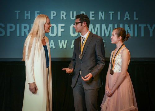 Olympic gold medalist and World Cup champion Lindsey Vonn congratulates Max Rubenstein, 18, of Atlanta (center) and Angelica Krubeck, 11, of Cumming (right) on being named Georgia's top two youth volunteers for 2018 by The Prudential Spirit of Community Awards. Max and Angelica were honored at a ceremony on Sunday, April 29 at the Smithsonian's National Museum of Natural History, where they each received a $1,000 award.
