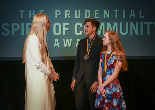 Olympic gold medalist and World Cup champion Lindsey Vonn congratulates Kaleb Cook, 18, of Robins (center) and Arika Hammond, 14, of Cherokee (right) on being named Iowa's top two youth volunteers for 2018 by The Prudential Spirit of Community Awards. Kaleb and Arika were honored at a ceremony on Sunday, April 29 at the Smithsonian's National Museum of Natural History, where they each received a $1,000 award.