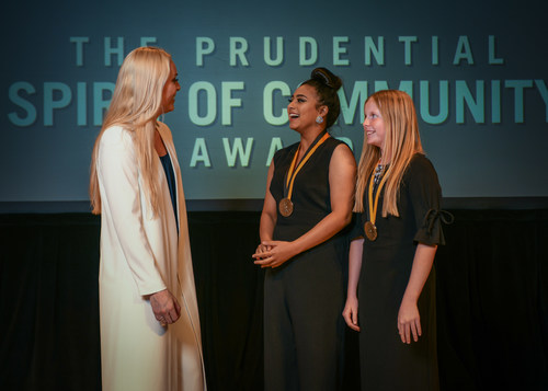 Olympic gold medalist and World Cup champion Lindsey Vonn congratulates Mahealani Sims-Tulba, 18, of Ewa Beach (center) and Grace Kennedy, 13, of Kailua (right) on being named Hawaii's top two youth volunteers for 2018 by The Prudential Spirit of Community Awards. Mahealani and Grace were honored at a ceremony on Sunday, April 29 at the Smithsonian's National Museum of Natural History, where they each received a $1,000 award.