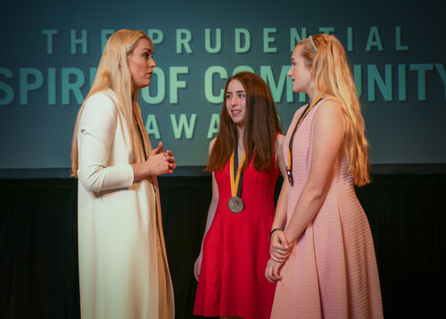 Olympic gold medalist and World Cup champion Lindsey Vonn congratulates Alexa Grabelle, 16, of Voorhees (center) and Rileigh Leighton, 14, of Williamstown (right) on being named New Jersey's top two youth volunteers for 2018 by The Prudential Spirit of Community Awards. Alexa and Rileigh were honored at a ceremony on Sunday, April 29 at the Smithsonian's National Museum of Natural History, where they each received a $1,000 award.