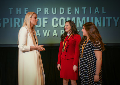 Olympic gold medalist and World Cup champion Lindsey Vonn congratulates Ashlen Wright, 18, of West Fargo (center) and Macy Vasquez, 14, of Grand Forks (right) on being named North Dakota's top two youth volunteers for 2018 by The Prudential Spirit of Community Awards. Ashlen and Macy were honored at a ceremony on Sunday, April 29 at the Smithsonian's National Museum of Natural History, where they each received a $1,000 award.