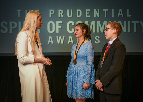 Olympic gold medalist and World Cup champion Lindsey Vonn congratulates Makenna Marchbanks, 17, of Blanchard (center) and Charles Carter, 14, of Elgin (right) on being named Oklahoma's top two youth volunteers for 2018 by The Prudential Spirit of Community Awards. Makenna and Charles were honored at a ceremony on Sunday, April 29 at the Smithsonian's National Museum of Natural History, where they each received a $1,000 award.