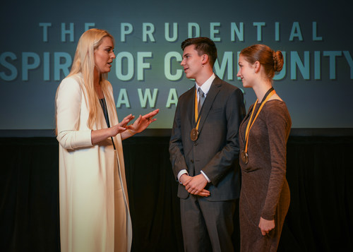 Olympic gold medalist and World Cup champion Lindsey Vonn congratulates Malcolm Asher, 16 (center) and Irie Page, 14 (right), both of Portland, on being named Oregon's top two youth volunteers for 2018 by The Prudential Spirit of Community Awards. Malcolm and Irie were honored at a ceremony on Sunday, April 29 at the Smithsonian's National Museum of Natural History, where they each received a $1,000 award.