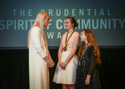 Olympic gold medalist and World Cup champion Lindsey Vonn congratulates Jetta Harvey, 16, of Beatrice (center) and Kadynce Mullins, 10, of Nebraska City (right) on being named Nebraska's top two youth volunteers for 2018 by The Prudential Spirit of Community Awards. Jetta and Kadynce were honored at a ceremony on Sunday, April 29 at the Smithsonian's National Museum of Natural History, where they each received a $1,000 award.