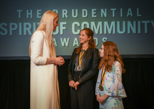 Olympic gold medalist and World Cup champion Lindsey Vonn congratulates Helena Zimmerman, 16, of Purchase (center) and Hailey Richman, 10, of Long Island City (right) on being named New York's top two youth volunteers for 2018 by The Prudential Spirit of Community Awards. Helena and Hailey were honored at a ceremony on Sunday, April 29 at the Smithsonian's National Museum of Natural History, where they each received a $1,000 award.