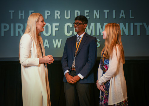 Olympic gold medalist and World Cup champion Lindsey Vonn congratulates Praneeth Alla, 16, of Exton (center) and Ashley Geesey, 13, of Bainbridge (right) on being named Pennsylvania's top two youth volunteers for 2018 by The Prudential Spirit of Community Awards. Praneeth and Ashley were honored at a ceremony on Sunday, April 29 at the Smithsonian's National Museum of Natural History, where they each received a $1,000 award.