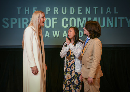 Olympic gold medalist and World Cup champion Lindsey Vonn congratulates Kira Andreucci, 17, of Fitchburg (center) and Harrison (Harry) Bennett, 12, of Malden (right) on being named Massachusetts' top two youth volunteers for 2018 by The Prudential Spirit of Community Awards. Kira and Harry were honored at a ceremony on Sunday, April 29 at the Smithsonian's National Museum of Natural History, where they each received a $1,000 award.