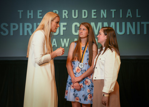 Olympic gold medalist and World Cup champion Lindsey Vonn congratulates Alyssa Gottheiner, 15, of Manning (center) and Gracey Chafin, 11, of Graniteville (right) on being named South Carolina's top two youth volunteers for 2018 by The Prudential Spirit of Community Awards. Alyssa and Gracey were honored at a ceremony on Sunday, April 29 at the Smithsonian's National Museum of Natural History, where they each received a $1,000 award.