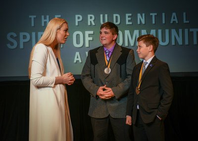 Olympic gold medalist and World Cup champion Lindsey Vonn congratulates Logan Grosz, 18, of Torrington (center) and Seamus Casey, 14, of Gillette (right) on being named Wyoming's top two youth volunteers for 2018 by The Prudential Spirit of Community Awards. Logan and Seamus were honored at a ceremony on Sunday, April 29 at the Smithsonian's National Museum of Natural History, where they each received a $1,000 award.