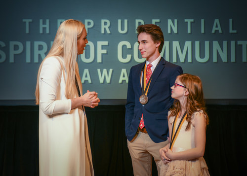 Olympic gold medalist and World Cup champion Lindsey Vonn congratulates Oscar Kavanagh, 18, of Brookings (center) and Bria Neff, 11, of Sioux Falls (right) on being named South Dakota's top two youth volunteers for 2018 by The Prudential Spirit of Community Awards. Oscar and Bria were honored at a ceremony on Sunday, April 29 at the Smithsonian's National Museum of Natural History, where they each received a $1,000 award.