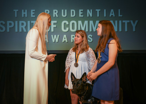 Olympic gold medalist and World Cup champion Lindsey Vonn congratulates Tabitha Bell, 18 (center) and Abigail Slama-Catron, 13 (right), both of Sandy, on being named Utah's top two youth volunteers for 2018 by The Prudential Spirit of Community Awards. Tabitha and Abigail were honored at a ceremony on Sunday, April 29 at the Smithsonian's National Museum of Natural History, where they each received a $1,000 award.