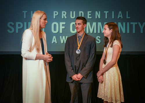Olympic gold medalist and World Cup champion Lindsey Vonn congratulates Samuel Grandfield, 18, of Waterbury (center) and Ella Byers, 13, of Shelburne (right) on being named Vermont's top two youth volunteers for 2018 by The Prudential Spirit of Community Awards. Samuel and Ella were honored at a ceremony on Sunday, April 29 at the Smithsonian's National Museum of Natural History, where they each received a $1,000 award.