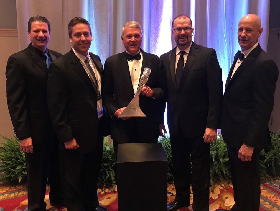 Bruce McDonald (center), chairman and CEO for Adient, accepts GM Overdrive Award during General Motors's 26th annual Supplier of the Year awards ceremony.