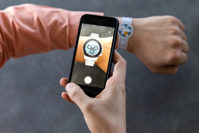 The WatchBox AR component allows customers to see how a watch will look on their wrists before buying online.