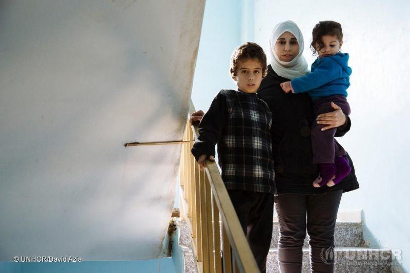 Jordan. Syrian female headed refugee family receiving cash assistance. (PRNewsfoto/Zakat)
