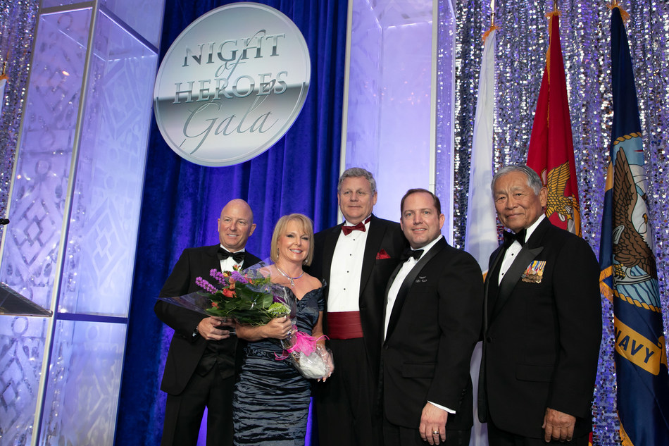 Pete and Debbie Hilger are honored as the Corporate Hero Honorees. Pictured left to right: Allied Solutions CEO Pete Hilger and his wife Debbie, PenFed Foundation Acting President and COO Bruce Kasold, PenFed Credit Union President and CEO James Schenck, and PenFed Foundation Chair The Honorable Frederick Y. Pang.