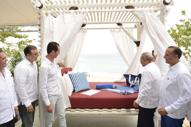 Pictured above is Xavier Mufraggi (left), CEO of Club Med North America and H. E. Danilo Medina Sánchez (right), President of the Dominican Republic, officially opening the curtains of the hallmark icon for Club Med Michès - the resort's first cabana – as part of the groundbreaking event.