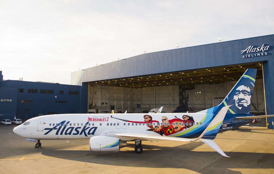 """Ahead of the highly-anticipated release of Disney•Pixar's Incredibles 2 on June 15, Alaska Airlines unveiled a special-edition plane today, featuring moviegoers' favorite family of """"Supers."""" The Incredibles 2-themed plane, Alaska's first Disney•Pixar film livery, was unveiled to a crowd of more than 2,000 cheering students during Aviation Day at the airlines' Seattle hangar. The Incredibles 2-themed plane, tail number N519AS, begins flying throughout Alaska's route network Sunday."""