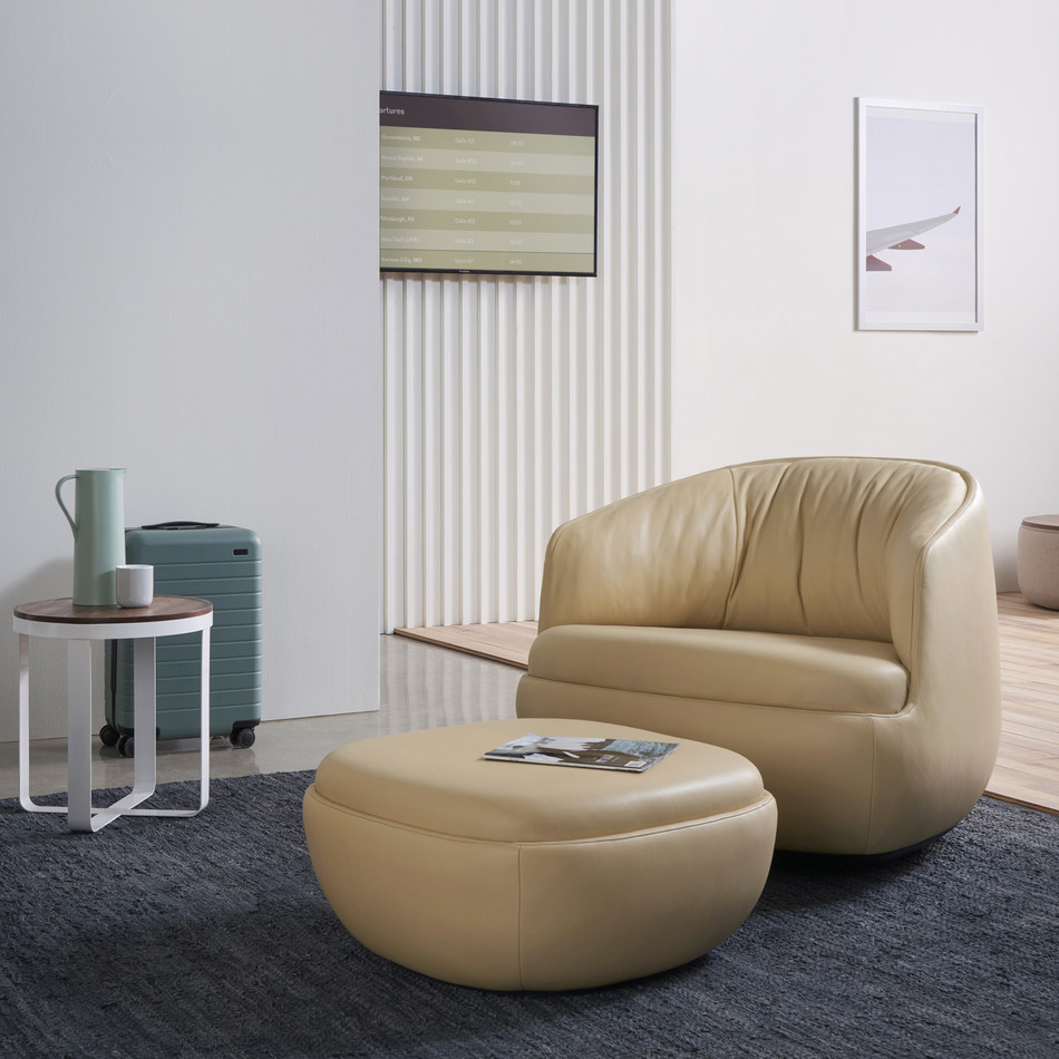 Gimbal Low Back Lounge Rocker from Hightower. Shown here with ottoman and Ribbon Table. All pieces designed by Most Modest.