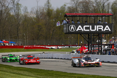 Helio Castroneves and Ricky Taylor combined to take their Acura ARX-05 to a commanding IMSA sports car victory Sunday at the Mid-Ohio Sports Car Course.