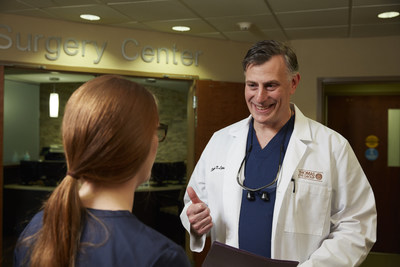 Stephen Lipsky, MD, a member of the American Academy of Ophthalmology, speaks with a patient.