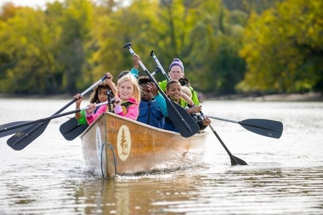 NPT's Buddy Bison School Program students canoeing along Anacostia River. Saturday, May 19 is Kids to Parks Day, nearly one million participants to attend 1000+ park events nationwide.