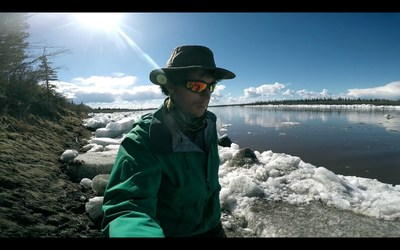 Adam Shoalts scouting out the ice along the Porcupine River (CNW Group/Royal Canadian Geographical Society)