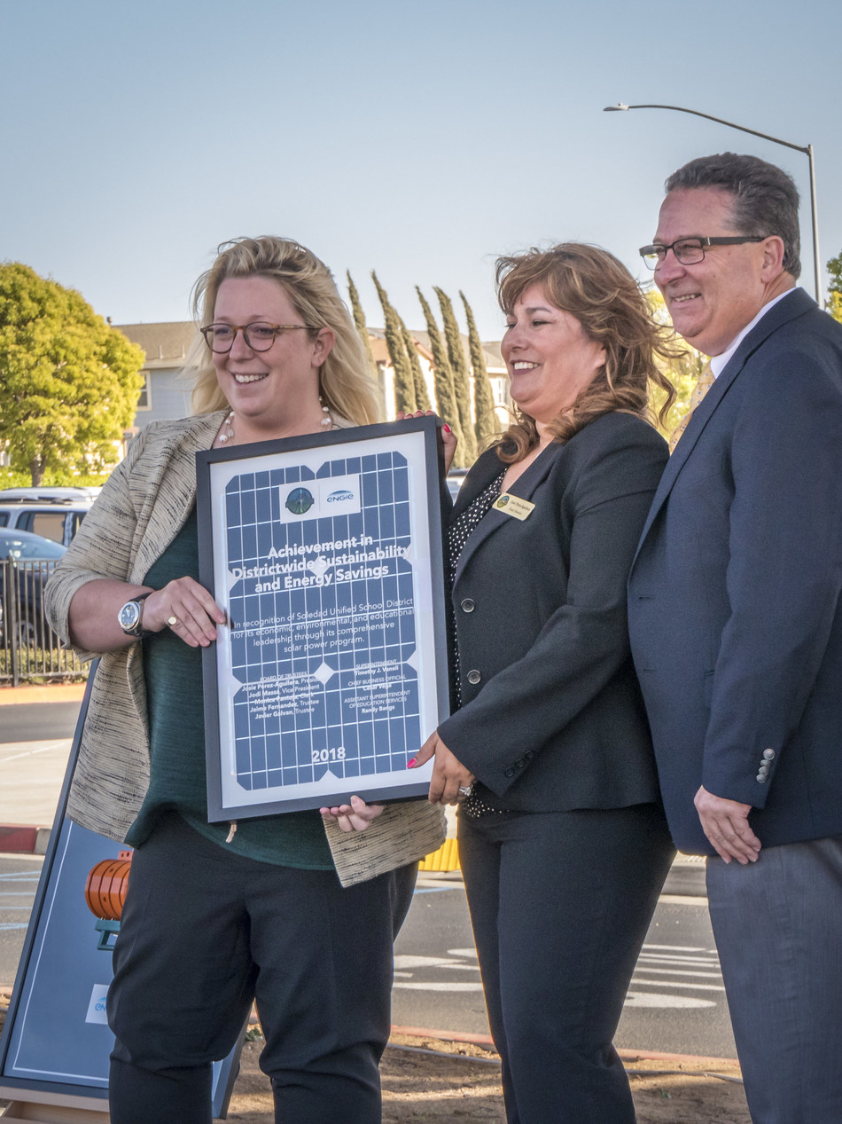 ENGIE Services U.S. Vice President Courtney Jenkins presents solar plaque to Soledad USD Board President Josie-Perez Aguilera and Soledad USD Superintendent Tim Vanoli in recognition of the completion of the District's 1.14 MW solar program.
