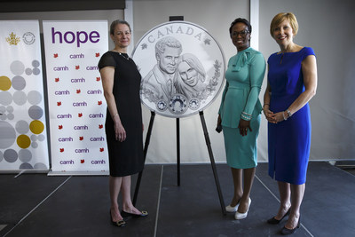From left: Royal Canadian Mint President & CEO Sandra Hanington, Parliamentary Secretary to the Minister of International Development Celina Caesar-Chavannes and CAMH Foundation President & CEO Deborah Gillis unveil a silver collector coin celebrating the royal wedding of Prince Harry and Ms Meghan Markle (Toronto, May 9, 2018). (CNW Group/Royal Canadian Mint)