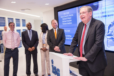 Stamford Mayor David R. Martin is shown speaking at the grand opening of the new Information Services Group (ISG) global headquarters at 2187 Atlantic Street in Stamford, Connecticut, on May 9, 2018. With the mayor are (from left) Michael Handler, chief financial officer of the City of Stamford; Michael Pollard, chief of staff to the mayor; Gloria DePina, member of the Stamford Board of Representatives and an aide to U.S. Representative Jim Himes; and Thomas Madden, director of economic development for the City of Stamford. The officials were on hand to mark the opening of ISG's new state-of-the art facility, a digital showcase for the Workplace of the Future, in the Harbor Point area of Stamford. ISG is a leading global technology research and advisory firm and a trusted business partner to more than 700 clients, including 75 of the top 100 enterprises in the world.