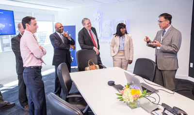 Mark Davison (right), partner, ISG Robotic Process Automation (RPA), discusses the principles of process automation with local government officials today, May 9, 2018, in the ISG Digital Experience Center, located in the new ISG global headquarters at 2187 Atlantic Street in Stamford, Connecticut.  From left are Michael Handler, chief financial officer of the City of Stamford; Michael Pollard, chief of staff to Stamford Mayor David R. Martin; Mayor Martin, and Gloria DePina, member of the Stamford Board of Representatives and an aide to U.S. Representative Jim Himes. The officials were on hand to mark the opening of ISG's new state-of-the art facility, a digital showcase for the Workplace of the Future, located in the Harbor Point area of Stamford. ISG is a leading global technology research and advisory firm and a trusted business partner to more than 700 clients, including 75 of the top 100 enterprises in the world.