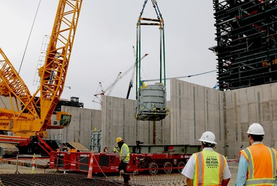 Vogtle Unit 4 step-up transformer is lifted into place in May 2018.