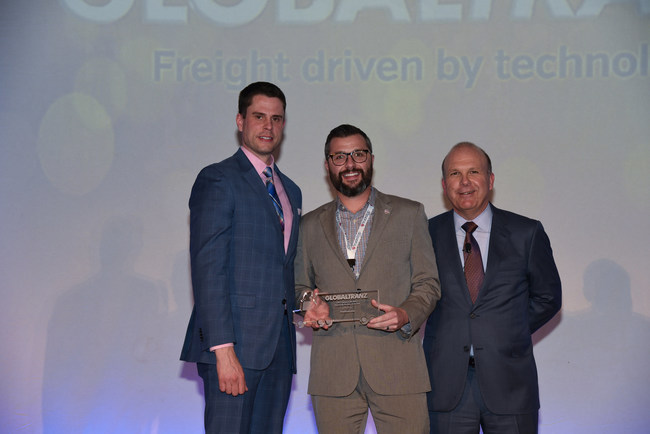 Peter Jass from Truckstop.com accepting the award. Dave Bush - SVP, Carrier Relation of Globaltranz to the left. Bob Farrell - Chairman and CEO of GlobalTranz to the right.