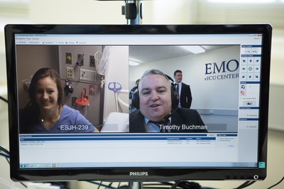 Tim Buchman, Director of the Critical Care Center, Emory Healthcare connects with eICU nurse in Atlanta, GA
