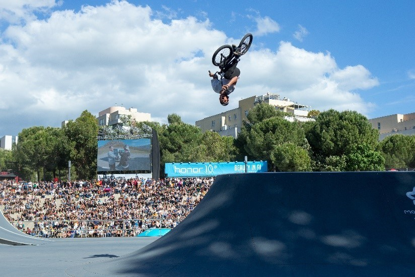 A professional BMX athlete conquering the quarter-pipe