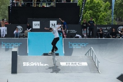 A skateboarder demonstrating excellent skills flying over the grind rail