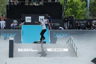 A skateboarder demonstrating excellent skills flying over the grind rail