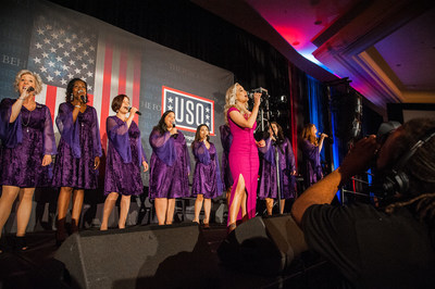 "Kellie Pickler, an 11-time USO tour veteran, performed ""God Bless America"" with the American Military Spouses Choir and shared her own personal commitment to the USO's effort."