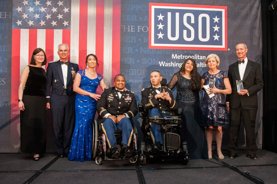 (Left to right): Mrs. Ricki Selva and her husband General Paul Selva, Vice-Chairman of the Joint Chiefs of Staff; service members and their spouses; Mrs. Sally Thornberry, recipient of the USO-Metro's 2018 Patriot Award and wife of Congressman Mac Thornberry, Chairman of the House Armed Services Committee.