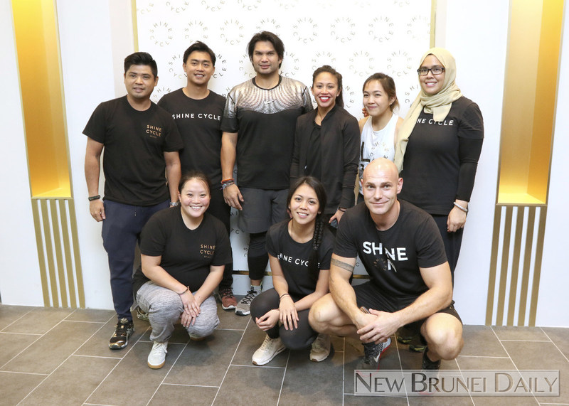 HRH Princess 'Azemah Ni'matul Bolkiah (3R) and YAM Pengiran Muda Bahar (3L), proud owners of the Shine Cycle Studio together with their talented staff. (PRNewsfoto/Indoor Cycle Design)