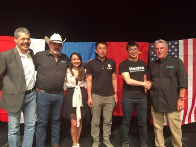 Jasen Wang shaking hands with Russ Fisher-Ives at the 2018 RoboRAVE International