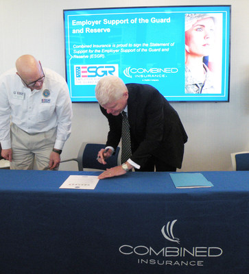 Kevin Goulding, President, Combined Insurance, signs the Statement of Support for Employer Support of the Guard and Reserve alongside Bob Nachman, City of Chicago Area Chair for ESGR.